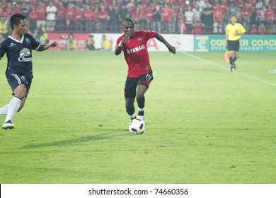 BANGKOK THAILAND - APRIL 2 BOUBACAR (red) in action at Thai  Premier League (TPL) between Muang Thong utd (Red) vs Buriram Fc (Blue) on April 2, 2011 at Yamaha Stadium Bangkok, Thailand