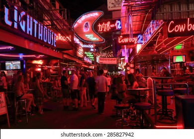 BANGKOK THAILAND - APRIL 20, 2015: Unidentified people visit Soy Cowboy. Soy Cowboy is a 150 meter long street with some 40, mostly go-go bars in Bangkok which is similar to Nana Plaza.