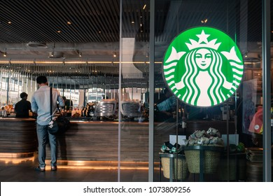 Bangkok, Thailand - April 20, 2018 : Starbucks coffee logo in front of the shop.