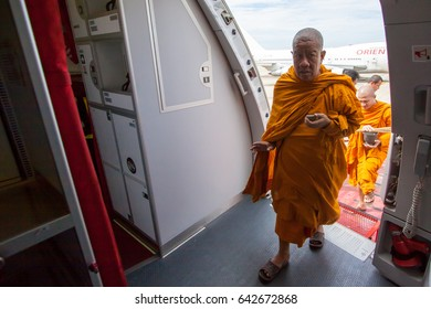 Bangkok , Thailand , April 2016 : Thai monk getting inside Thai AirAsia X's airplane to make a merit