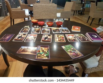 BANGKOK, THAILAND - April 2019:  Century Spice Road, the first in a series of games that explores the history of each century with spice-trading, game is set on the wooden desk