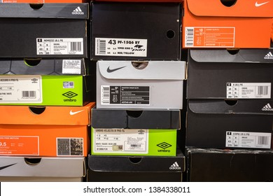 Bangkok / Thailand - April 2019 : Football shoe container boxes of varies brand are stack up in orderly, like keeping in collector room or shopping store. Pattern background photo.