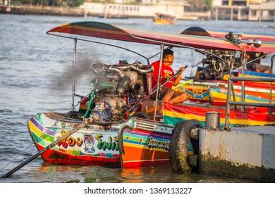 Bangkok, Thailand - April 2019: Long boat man on the Chao Phraya River in Bangkok, Thailand