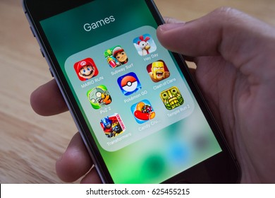 Bangkok, Thailand - April 21, 2017 : Apple iPhone5s showing its screen with Pokemon Go, Mario Run and other popular game applications.
