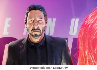 Bangkok, Thailand - April 21, 2019: John Wick Model With a beautiful standee of a movie called John Wick Chapter 3 Parabellum display showing at cinema
