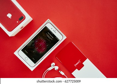 BANGKOK, THAILAND - April 22, 2017: Top view of New iPhone 7 Plus front side show Lock Screen in package box with red background, Special Edition of Apple Product Red