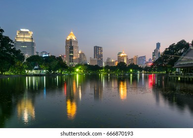 Bangkok, Thailand - April 22, 2017 : Business district with Bangkok skyline. Lumpini Park is a popular place for walks and sport activities.