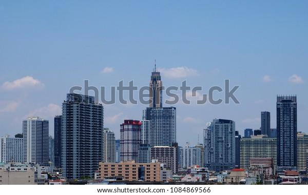 BANGKOK, THAILAND - APRIL 22, 2018: Modern buildings rise in blue sky on April 22, 2018 in Thai capital Bangkok.