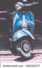 """BANGKOK, THAILAND : april 23, 2009 : """"The vespa sprint black matte vintage scooter motorcycle on a vintage Background"""" in Bangkok, Thailand."""