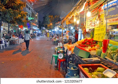 Bangkok, Thailand - April 23, 2015: Street food stall and bars by night in Soi Rambuttri, a pedestrian alley near Khao San Road with a lot of street food vendors, bars and cheap guesthouses.