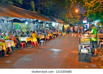 Bangkok, Thailand - April 23, 2015: Big street food stall by night in Soi Rambuttri, a pedestrian alley near Khao San Road with a lot of street food vendors, bars and cheap guesthouses.