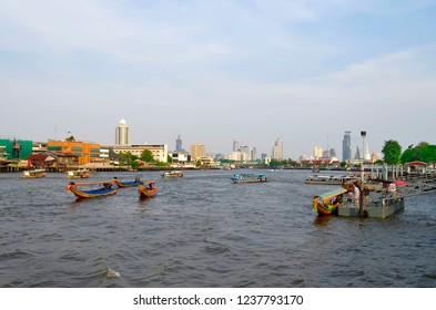 Bangkok, Thailand - April 23, 2015: Traffic on the Chao Phraya River with skyscrapers in the background.