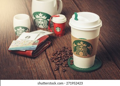BANGKOK, THAILAND - APRIL 23, 2015: White paper cup and other gift with Starbucks logo. Starbucks is the world's largest coffee house with over 20,000 stores in 61 countries.