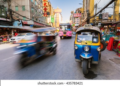 Bangkok, Thailand - April 24, 2016: Tuk-tuk taxi parked near street market in Chinatown on April 24, 2016 in Bangkok, Thailand.