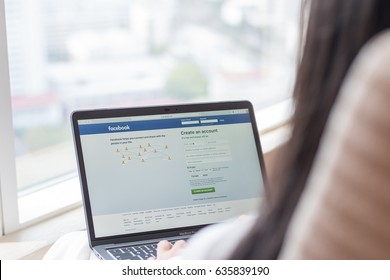BANGKOK, THAILAND - April 24, 2017: Facebook social network on pc  laptop with user sign up/ in registration screen working from home workplace.
