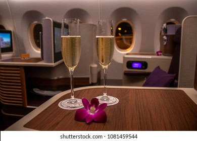BANGKOK, THAILAND - APRIL 24, 2018: Two glasses of champagne served as welcome drinks in the Business class section at a Thai Airway's Beoing 747 route from Bangkok to Seoul.