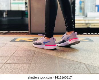 BANGKOK, THAILAND. APRIL 24, 2019: the woman wears running shoes Nike Odyssey React, standing on the BTS platform.