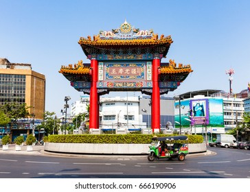 BANGKOK, THAILAND - APRIL 24: Traditional Thai taxi with Chinatown Gate on background on April 24, 2016 in Bangkok, Thailand.
