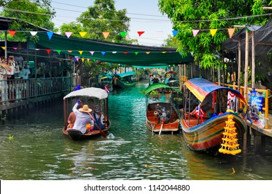 Bangkok, Thailand - April 25, 2015: Boat rides on the khlong of Khlong Lat Mayom floating market, weekend getaway of Bangkokian families.