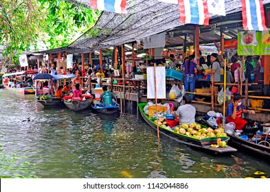 Bangkok, Thailand - April 25, 2015: Preparing Thai food on boats at Khlong Lat Mayom floating market, a market dedicated to fruit and vegetable and above all to take away Thai food.