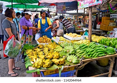 Bangkok, Thailand - April 25, 2015: Fruit and vegetable vendor at Khlong Lat Mayom floating market, a market dedicated to fruit and vegetable and above all to take away Thai food.
