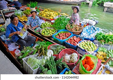 Bangkok, Thailand - April 25, 2015: Fruit and vegetable vendors on boats at Khlong Lat Mayom floating market, a market dedicated to fruit and vegetable and above all to take away Thai food.