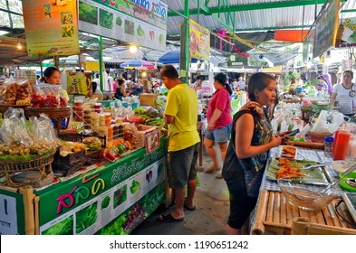 Bangkok, Thailand - April 25, 2015: Take away food stalls at Khlong Lat Mayom floating market, a place where Bangokian families like to spend several hours during the week-end.