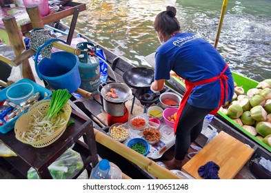Bangkok, Thailand - April 25, 2015: Preparing Thai food on boats at Khlong Lat Mayom floating market, a market dedicated to fruit and vegetable and above all to take away Thai food.