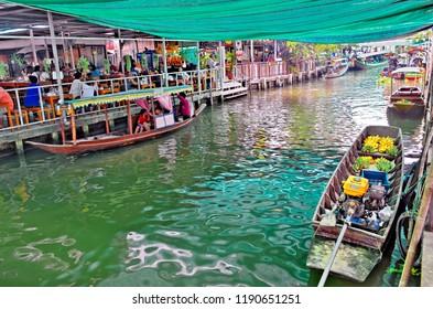 Bangkok, Thailand - April 25, 2015: Boat rides on the khlong of Khlong Lat Mayom floating market, weekend getaway of Bangkokian families.