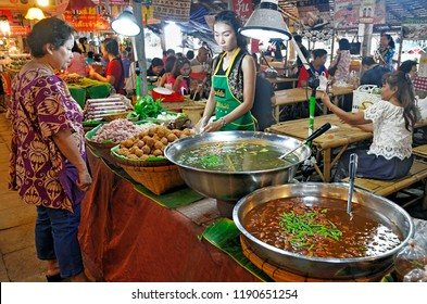 Bangkok, Thailand - April 25, 2015: Take away food stall at Khlong Lat Mayom floating market, a place where Bangokian families like to spend several hours during the week-end.