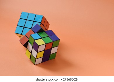 BANGKOK, THAILAND- APRIL 25, 2015: Rubik's cube on orange background, Rubik's cube invented by a Hungarian architect Erno Rubik in 1974.