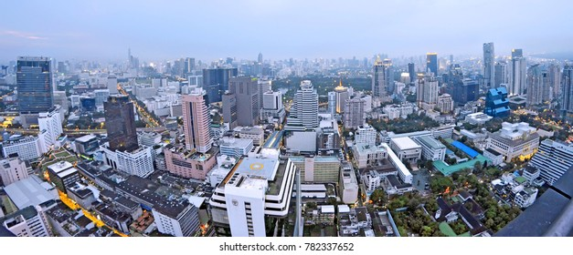 Bangkok, Thailand - April 25, 2015. Silom buildings and Lumpini Park at dusk from a rooftop bar.