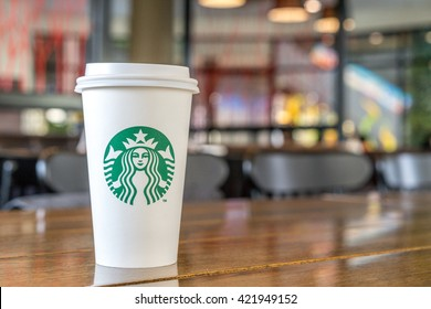 BANGKOK, THAILAND - April 25, 2016: Starbucks hot beverage coffee with holder on the table of Starbucks Sena Fest branch.