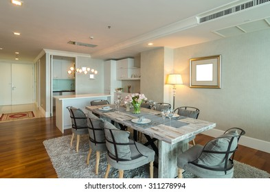 BANGKOK, THAILAND - APRIL 25 :  Luxury Interior living room with kitchen zone and restaurant set at My resort as river condominium beside the chao phraya river on April 25, 2015 in Bangkok, Thailand