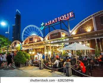 BANGKOK THAILAND - APRIL 25: Outdoor Restaurant in Asiatique The riverfront in night time in Bangkok, on April 25, 2017 in Bangkok, Thailand.