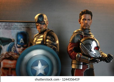 BANGKOK THAILAND - APRIL 26 ,2017 : Close up shot of Captain America and Antman Civil War superheros figure in action fighting. Captain america appearing in American comic books by Marvel.