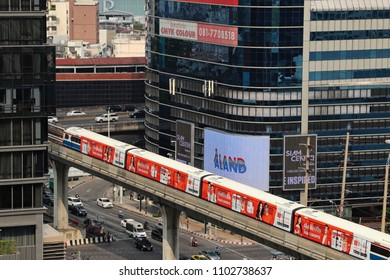 Bangkok, Thailand - April 27, 2018: A cityscape image featuring the Bangkok mass transit system (BTS Skytrain) which transports thousands of locals and tourists around the city everyday.