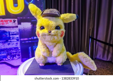 Bangkok, Thailand - April 27, 2019: Pikachu Model With a beautiful standee of a movie called Pokémon Detective Pikachu display showing at cinema