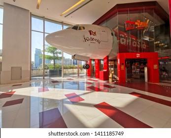 Bangkok, Thailand - April 28, 2019: Air Asia airplane or jet decorated at Kidzania amusement in Paragon shopping mall with Bangkok coty view.