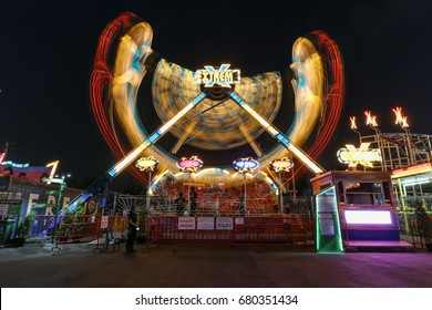 BANGKOK, THAILAND - APRIL 28: Abstract blurry light long exposure swing player name Extreme in amusement park April 28, 2016 at Bangkok, Thailand.