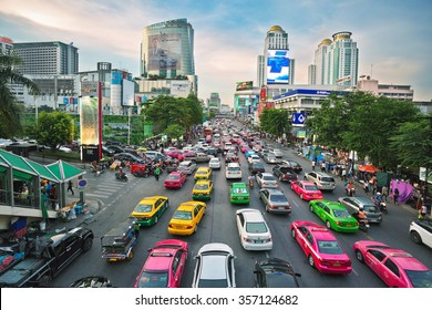 BANGKOK, THAILAND - APRIL 29, 2015: Taxis in Bangkok are in a traffic jam. There are 150,000 taxis in Bangkok. All are metered with the starting fee of 35 Baht for the first 3 kilometers.