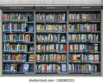 BANGKOK, THAILAND - APRIL 29, 2016: Coporate Finance And Economics Books For Rent To Read On Library Shelf.