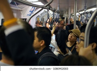 Bangkok Thailand - April 29, 2018: Full the passengers standing and waiting inside BTS skytrain, Busy and packed with people in rush hour, Transportation of the Bangkok Mass Transit System
