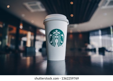 Bangkok ,Thailand - April 4 2019 : A cup of take home Starbucks Cappuccino coffee on the table in the Starbucks coffee shop.