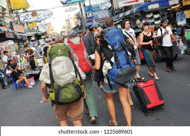 Bangkok, Thailand - April 5, 2012: Tourists walk along Khao San Road. Budget accommodation in the Khao San area starts from $6 or B200 per night and is popular with pack packers, expats and locals.