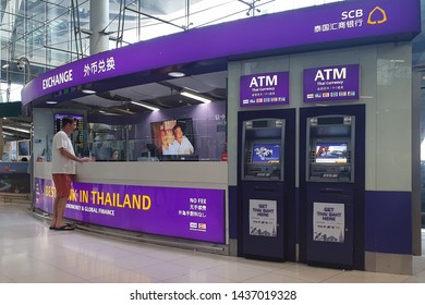 BANGKOK, THAILAND - April 5, 2019 : Interior view of a SCB Bank Currency Exchange Counter and ATMs (automated teller machines) at Suvarnabhumi Airport.