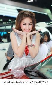 BANGKOK, THAILAND - APRIL 6, 2014: Unidentified model with Mitsubishi in the 35th Bangkok International Motor Show on April 6, 2014 in Bangkok, Thailand.