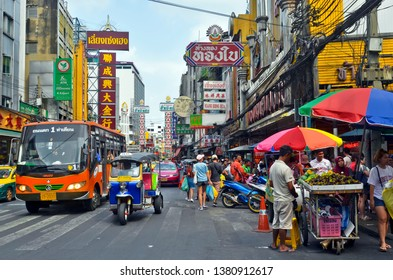 Bangkok, Thailand - April 7, 2019 : Colorful commercial signboards in Chinese characters in the bustling Yaowarat Road in Chinatown.