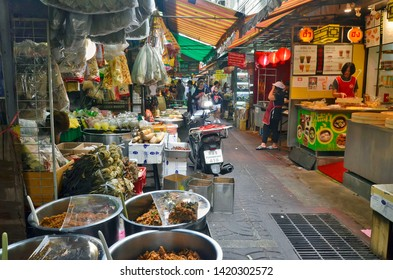 Bangkok, Thailand - April 7, 2019: An alley in Old Market near Yaowarat Road in Chinatown.