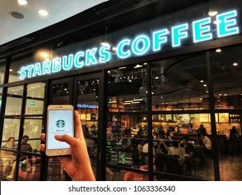 Bangkok, Thailand - APRIL 7,2018: Starbucks app on the Apple iPhone display screen. opening online menu page of Starbucks website, Starbucks coffee shop.